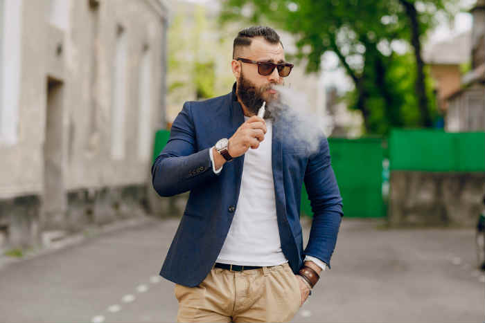 man walking and vaping